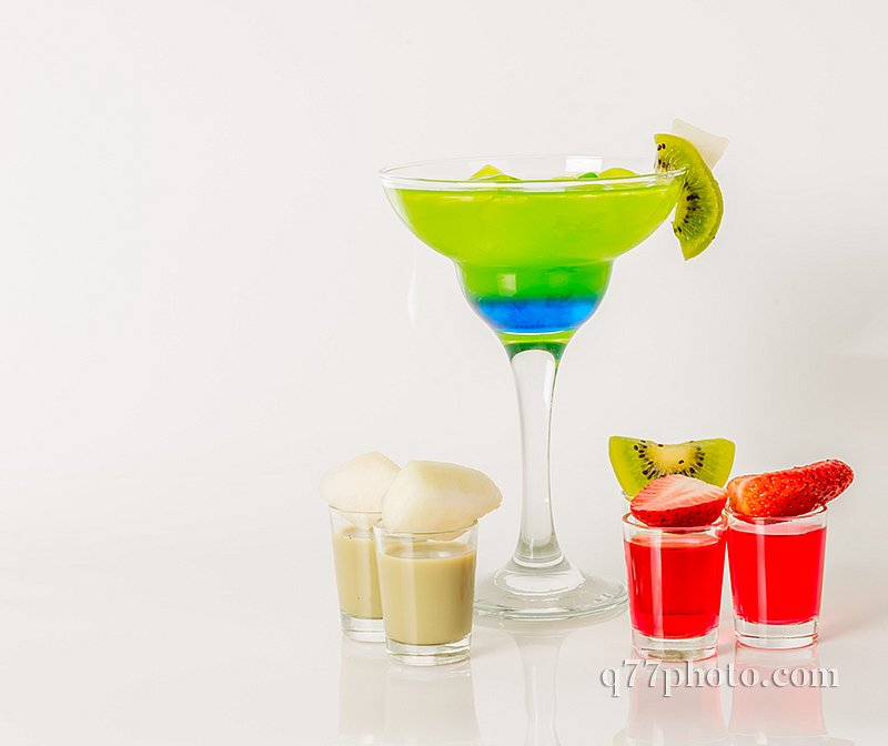 Colorful drink in a margarita glass, blue and green combination,