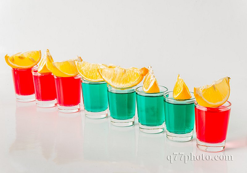 Glasses with green and red kamikaze, glamorous drinks, mixed dri