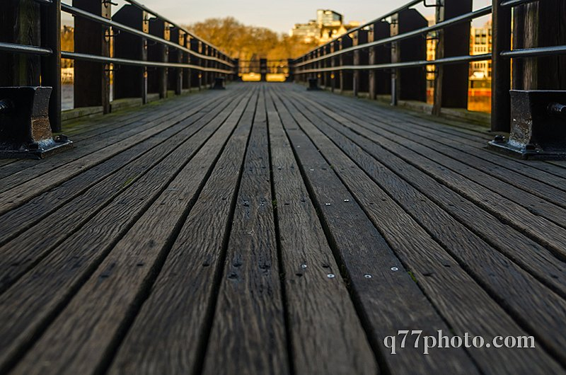 view on a wooden floor in a small pier on the river